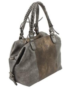 Die Handtasche ist DAS Statussymbol der Frau.